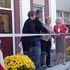 From left, Newtown Middle School Principal Diane Sherlock, John Donnery of Silktown Roofing, First Selectman Pat Llodra, and Superintendent of Schools Janet Robinson stand together just before Mrs Llodra cut the ceremonial white ribbon marking the official end to the Newtown Middle School roof project on Monday, October 17.  (Hallabeck photo)