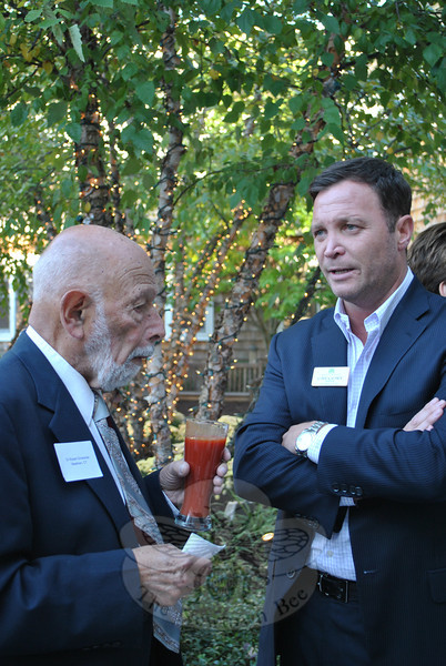Gregory Smith, right, CEO of Maplewood at Newtown, discusses his philosophy of using locally raised foods at the assisted living and memory care facility with Dr Robert Grossman, at a special Farm to Table reception hosted by Mr Smith and Chef Michael Bick of Some Things Fishy in Bethel.  (Crevier photo)