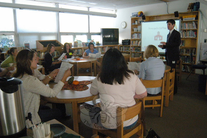 Middle Gate Principal Chris Geissler, right, spoke at his school's first Principal's Coffee meeting of the school year on Tuesday, October 11, to gathered parent visitors to the school.  (Hallabeck photo)