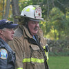 Firefighters from all five of Newtown's companies responded to a structure fire at 1 Winslow Road on Sunday, October 16. Deputy Fire Marshals Steve Ketchum (left) and Richard Frampton were also on the scene. No injuries were reported during the incident, but the house received substantial damage.  (Hicks photo)