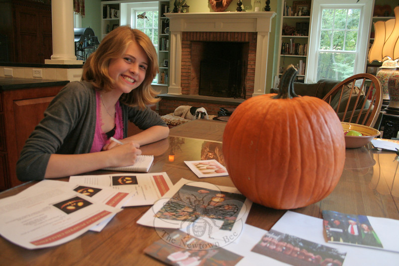 "Mackenzie Page is inviting everyone to ""get their pumpkin on."" The 13-year-old has launched The Great Pumpkin Challenge, inviting the public to create a jack-o'-lantern for a Halloween display at 14 Main Street.  (Hicks photo)"