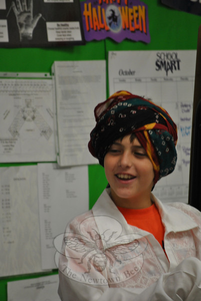 Sixth grade student Mark Hall models a turban wrapped around his head during a special presentation by Sandeep and Monju Kapur, who grew up in India. (Crevier photo)