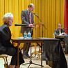 Newtown First Selectman Pat Llodra responds to a question posed by debate moderator and Newtown Bee Editor Curtiss Clark, center, while first selectman challenger William Furrier listens.  (Bobowick photo)