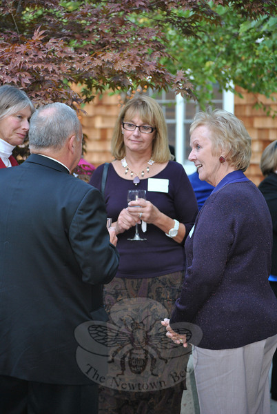 From left, Deb Osborne, VNA of Newtown, Monsignor Robert Weiss of St Rose of Lima Catholic Church, Mary Tietjen, VNA of Newtown, and Pat Llodra, Newtown first selectman, greet each other at the Farm to Table reception at Maplewood at Newtown on October 5.  (Crevier photo)