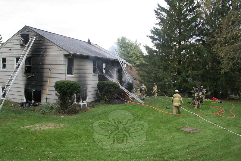 Firefighters from all five of Newtown's companies responded to a structure fire at 1 Winslow Road on Sunday, October 16.   No injuries were reported during the incident, but the house received substantial damage.  (Hicks photo)