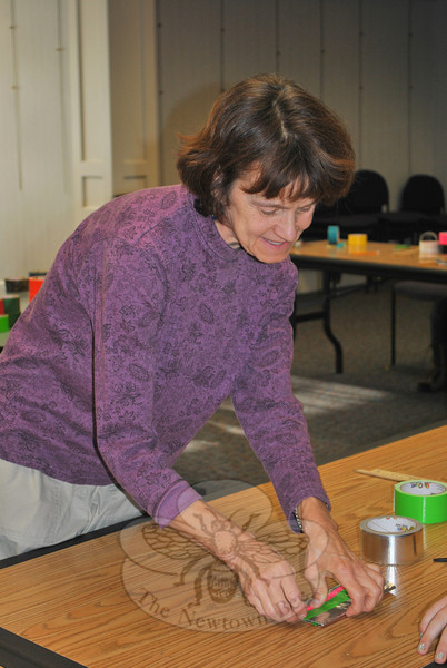 "A dozen young people joined area artist and teacher Katie Stevenson on Monday, October 17, for the Duct Tape VIII ""Unwind Your Imagination"" program at the C.H. Booth Library.  (Crevier photo)"