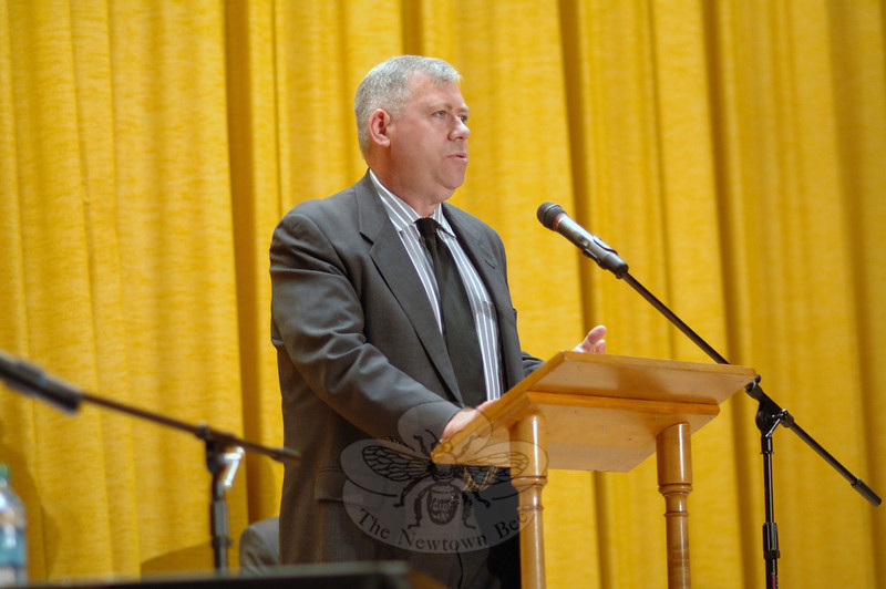 "Will Rodger outlines the financial reforms that he has helped to accomplish during his two-year tenure on the Board of Selectman, working closely with First Selectman Pat Llodra, and notes their efforts to dispel ""distrust and paranoia,"" during opening remarks at the Newtown Bee Debate. (Bobowick photo)"