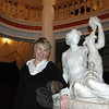 "As the outreach director for the Danbury Palace Theater, Newtown resident Carol Spiegel is working to help refamiliarize regional audiences and other possible clients with all this small but highly accessible performing arts and event space has to offer. She is pictured here in the theater beside the marble statue of ""Esmerelda,"" which has graced the lobby since 1928.  (Voket photo)"