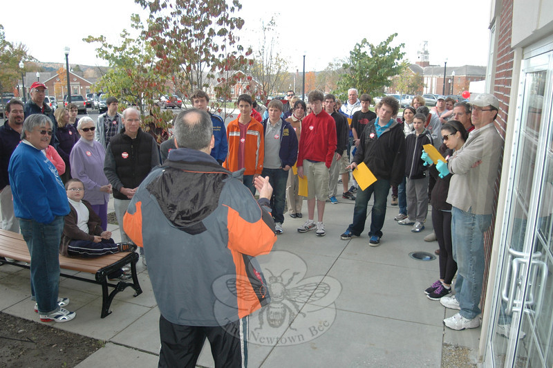 Reverend Matt Crebbin, senior minister of Newtown Congregation Church, preps a hearty crowd of several dozen who took to the trails and walkways of Fairfield Hills for the local 2011 CROP Walk to fight hunger and poverty.  (Voket photo)