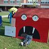 "Jaime Beaurline and Becca Kowalski get ready to settle down after putting the finishing touches on their ""Unhappy Meal"" scarecrow at Newtown Middle School on Saturday.  (Voket photo)<br /> <br /> NOTE: if you are looking for photos of a specific scarecrow, a separate gallery of NMS Sculpted Scarecrow photos has been created here:<br />  <a href=""http://photos.newtownbee.com/Events/NMS-2011-Sculpted-Scarecrow/19769290_pXCVLc#1553071841_mLXMZ2X"">http://photos.newtownbee.com/Events/NMS-2011-Sculpted-Scarecrow/19769290_pXCVLc#1553071841_mLXMZ2X</a>"