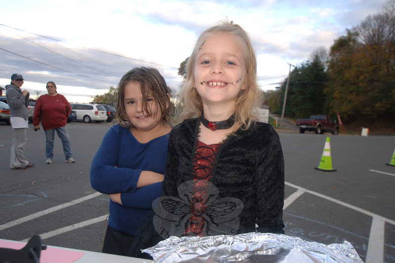 Taegan Smith wears a ruby choker, black gown, and bears stitches on her face as she and her friend Rebecca Filirto, left, join the fun during a Halloween party hosted by Newtown Police Explorers on Saturday, October 22.  (Bobowick photo)