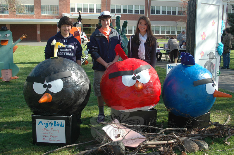 "Sam Cox, Nick Rohrbacher, and Alana Murray show off their ""Angry Birds"" entry, which also featured artistic input from Matt Maturo. (Voket photo)<br /> <br /> NOTE: if you are looking for photos of a specific scarecrow, a separate gallery of NMS Sculpted Scarecrow photos has been created here:<br />  <a href=""http://photos.newtownbee.com/Events/NMS-2011-Sculpted-Scarecrow/19769290_pXCVLc#1553071841_mLXMZ2X"">http://photos.newtownbee.com/Events/NMS-2011-Sculpted-Scarecrow/19769290_pXCVLc#1553071841_mLXMZ2X</a>"