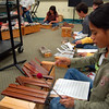 Reed sixth grade students worked on individual music compositions during a session of the school's Chinese music course on Tuesday, October 18.  (Hallabeck photo)