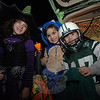 From left are witch Talia Ondy, hedgehog Ryan Gommo, and football player Gregory Gargano, who participated in St Rose's Trunk or Treat event on November 5.  (Bobowick photo)