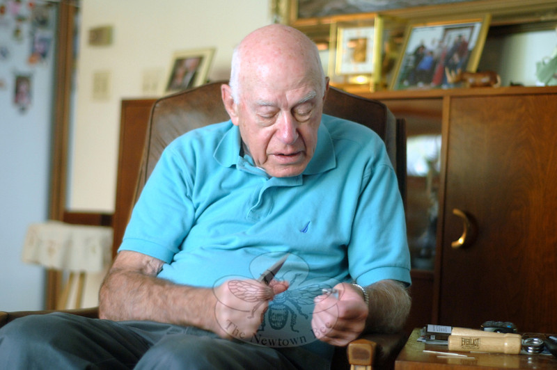 Oscar Berendsohn with artifacts left over from his work on top secret reconnaissance satellites in decades past.  (Bobowick photo)
