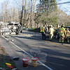Police report a two-vehicle collision near 148 Berkshire Road, which is close to that street's intersection with High Rock Road, at about 3:42 pm on November 4. Motorist Daniel Killday, 67, of Holts Summit, Missouri, was driving a 2007 Chevrolet pickup truck westward on Berkshire Road, as motorist Frederick Porrello, 56, of Branford, was driving a Ford Econoline van eastward there. The Chevrolet reportedly drifted into the opposite lane and then hit some rocks alongside the eastbound shoulder, after which it reentered the road and struck the Ford, causing the Ford to roll over onto its side. Killday, Chevrolet passenger Lloyd Stroppel, 68, of Macon, Missouri, and Porrello all were transported by ambulance volunteers to Danbury Hospital for medical evaluation. Sandy Hook and Botsford volunteer firefighters responded to the accident. Police issued Killday an infraction for failure to maintain the proper lane.  (Hicks photo)