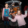 From left are Gracie and Sarah Bertsche and Caroline Hancock as they travel from trunk to trunk collecting candy at St Rose on November 5.  (Bobowick photo)