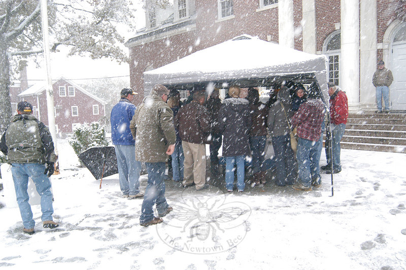 As a snowstorm moved in just before 1 pm on October 29, Newtown Lions Club members gathered beneath a portable shelter in front of Edmond Town Hall waiting for a raffle ticket to be drawn from among 7,700 entries for a 1965 Ford Mustang convertible.  (Gorosko photo)