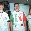 Students enrolled in Newtown High School's Italian program celebrated Italian heritage on Friday, October 14, with projects, food, a T-shirt design contest, and more. From left is John Corsi, Dan Spillane, and Kyra Murray, showing off their winning T-shirt designs.  (Hallabeck photo)