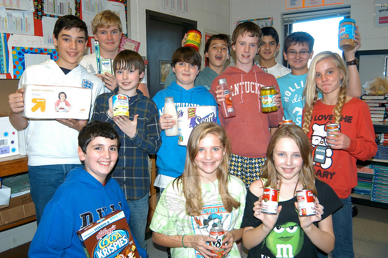 Members of Newtown Middle School's Student Council are collecting food and hygiene products through November 17 to donate to Women Involved in Newtown's annual Thanksgiving Basket campaign.  (Hallabeck photo)