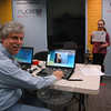 William Hillman, the master of Hiram Lodge #18 of the Ancient Free and Accepted Masons, works at a laptop computer where Kaiya Scott was being photographed as part of the Connecticut Child Identification Program held on October 29 at C.H. Booth Library. Through the free program the organization creates identification documents for children to be used by law enforcement agencies in the event that a child goes missing.  (Gorosko photo)