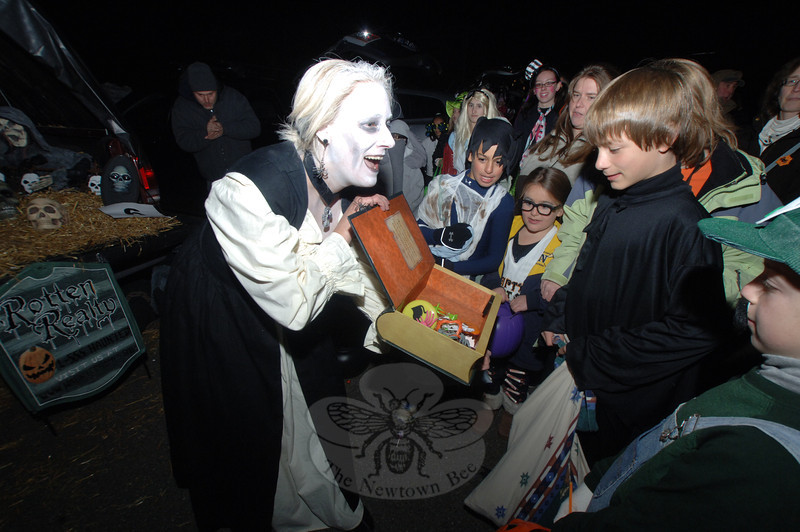 Mixing fun and fright, Kim McIntosh offers candy to trick-or-treaters at St Rose Church Saturday, November 5.  (Bobowick photo)