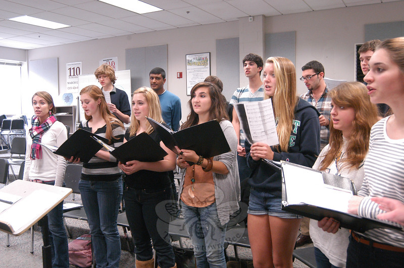 The Newtown High School Singers practiced on Wednesday, October 26, for the group's upcoming Madrigal Feaste.  (Hallabeck photo)