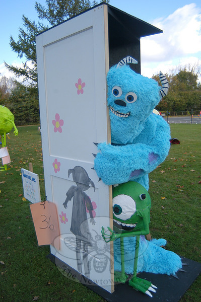 "The ""Monsters Inc"" scarecrow created by Sam Duffy, Michael Roche, Chris Grasso, and Kevin Finnegan took first place in this year's My Favorite Scarecrow Contest at Newtown Middle School.  (Hallabeck photo)"