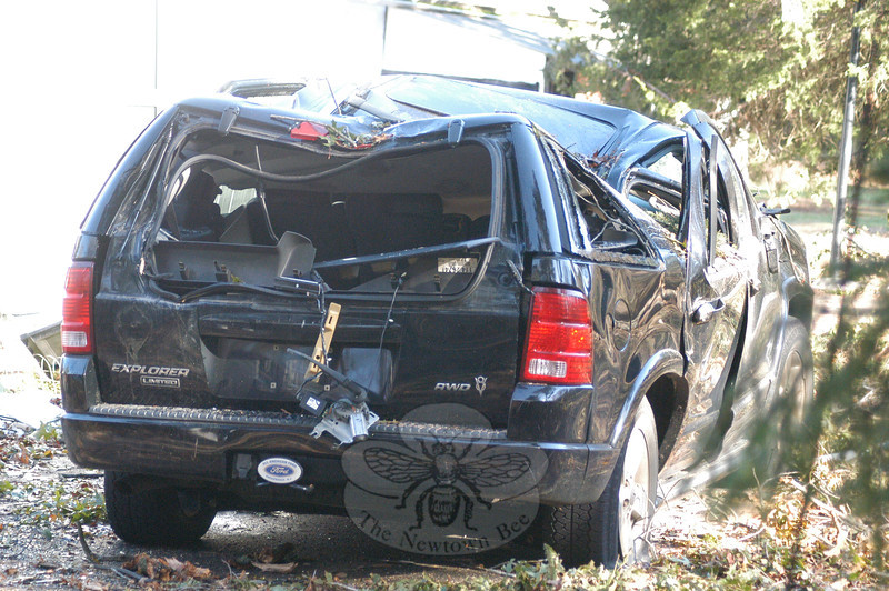 This Ford Explorer SUV, which was parked at a property on Little Brook Lane, received heavy body damage when a large tree fell squarely on it, collapsing its roof, following the freak October 29 snowstorm that hit the area causing extensive tree damage and power outages.  (Gorosko photo)