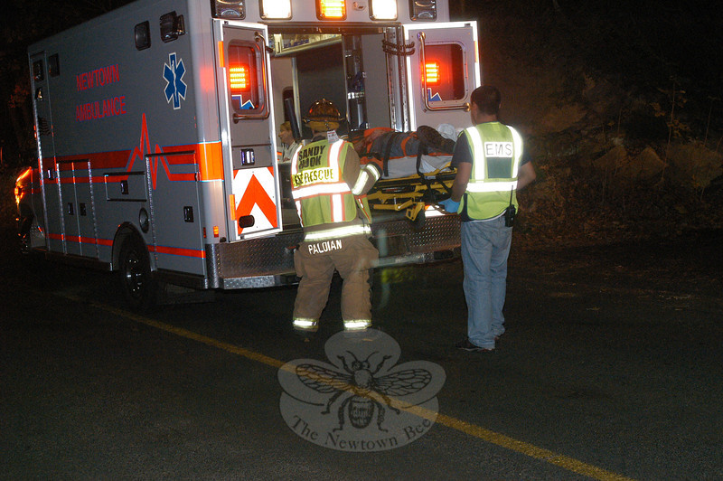 Sandy Hook Volunteer Fire & Rescue Company firefighters responded to a one-car rollover accident that occurred near 94 Riverside Road at about 6:14 pm on November 8. The identity of the driver involved in the accident is not yet available. Police said that on arriving at the scene, they found a Honda auto lying upside down in the middle of the road. The driver apparently had been traveling eastward when the vehicle crossed the road's center line and entered the westbound lane, striking an embankment along the westbound road shoulder, causing the auto to roll over. The auto then skidded on its roof for a distance. Newtown Ambulance volunteers transported the injured driver. Police ask anyone with information on the crash, which is under investigation, to contact them.  (Gorosko photo)