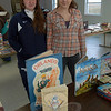 Newtown Girl Scouts Alexis Mulski, left, and Brianna Barnowski of Troop 50706 oversaw sales during this year's annual book sale and coat drive, held on Saturday, November 12, at Newtown United Methodist Church.  (Hallabeck photo)