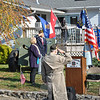 Sergeant Don Monckton, center, salutes the American flag during VFW Post 308 Veterans Day ceremonies on Friday, November 11, while First Selectman Pat Llodra and former Army National Guard Sergeant Richard Monckton pay their respects.  (Crevier photo)