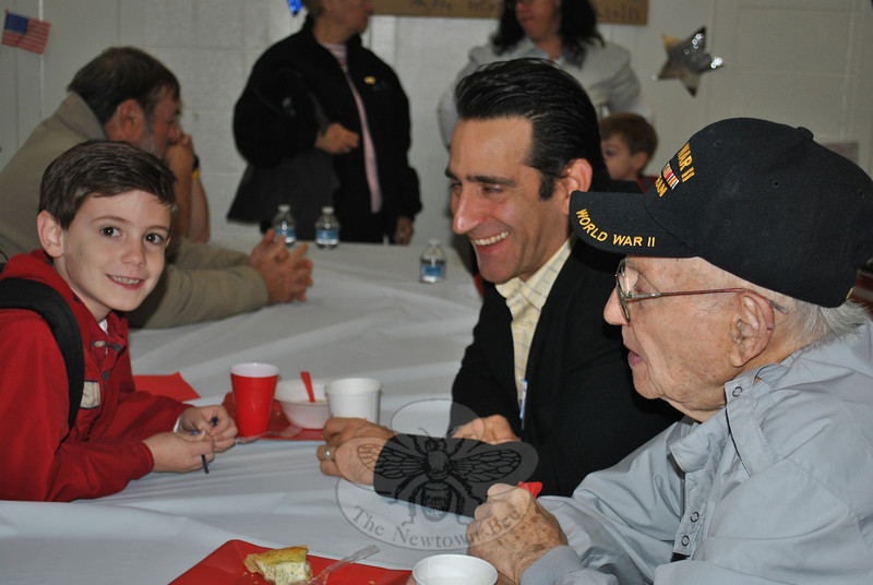 Among those gathered for Veterans Day 2011 at Sandy Hook School were, from left, Maxwell Barbagallo with his father Tony Barbagallo and grandfather Tony Barbagallo.  (Crevier photo)