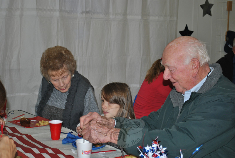 Lois and Bill Giniacki with their granddaughter, Lauren Young, during Veterans Day 2011 at Sandy Hook School.  (Crevier photo)