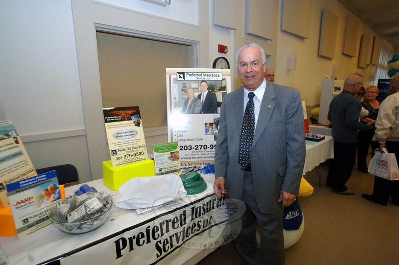 Jim Gulalo represents Preferred Insurance Services LLC during Destination Newtown.  (Bobowick photo)