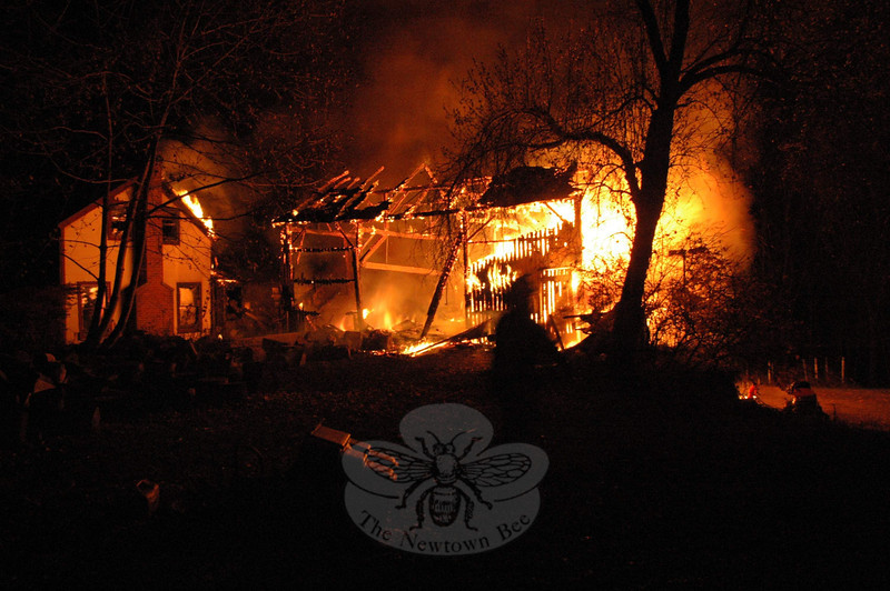 Firefighters were unable to save a barn from an accident fire at 46 Main Street on November 15. The antique structure was fully engulfed by flames when the first firefighters arrived on scene around 7:30 Tuesday night. A nearby house was damaged by the fire, but officials expect it to be habitable again.  (R. Scudder Smith photo)