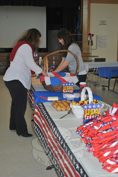 Cindy Mattioli and Laura Swanson set up breakfast prior to Veterans Day 2011 ceremonies at Sandy Hook School.  (Crevier photo)