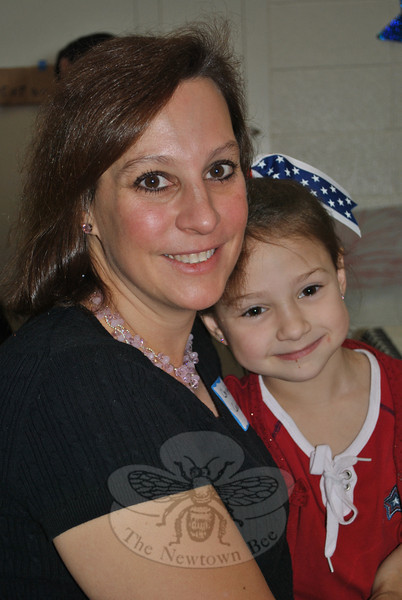 US Air Force veteran (1987–1992) Christine Calabrese joined daughter Julia, age 7, at the Sandy Hook School breakfast honoring veterans on Friday morning. Schools across town were offering special ceremonies so that students, faculty, and special guests could join together to honor veterans on Veterans Day 2011.  (Crevier photo)