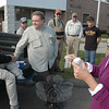 Scientist Ann Astarita, far right, examines a number of aquatic samples gathered by Candlewood Valley Trout Unlimited volunteers to assess the water quality of Deep Brook and the Pootatuck River. Among the many helpers who turned out for the annual late October exercise were, from left, Bill Bennett, George Hanson, Dick Rothe, Steve Zakur, Bill Dunn, and Sam Zakur.  (Voket photo)