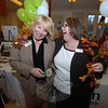 Kerry Gulick and Peggy Velthuizen share a laugh at the Union Savings Bank booth during Destination Newtown 2011. (Bobowick photo)