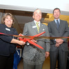 Cutting the ribbon and admitting guests to the 8th Annual Destination Newtown event presented by the Newtown Chamber of Commerce on Thursday, November 10, were Chamber President Ann Marie DeWeese with Newtown Savings Bank President and CEO John Trentacosta, and John Murphy, president and CEO of Danbury Health Systems and CEO of the Western Connecticut Health Network.  (Bobowick photo)