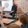 Chili's of Danbury Manager Lou Noujaim visited Middle Gate fourth graders in Linda Baron's classroom on Tuesday, November 15, to discuss math.  (Hallabeck photo)