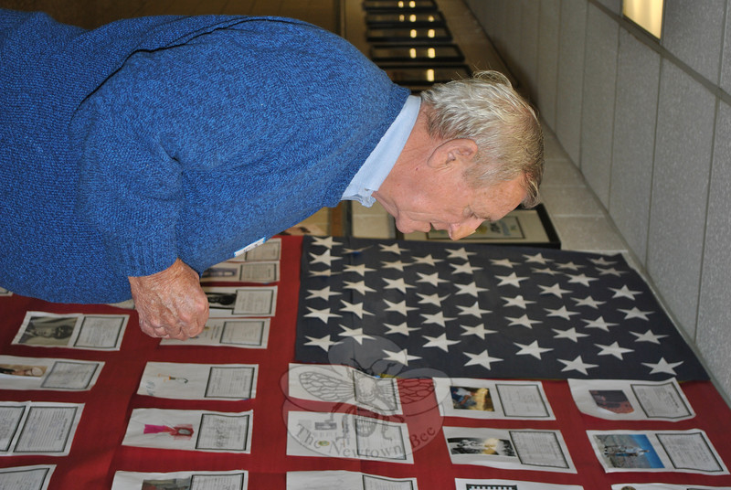 George Srebotnik looks at a tribute wall during Veterans Day 2011 at Sandy Hook School.  (Crevier photo)