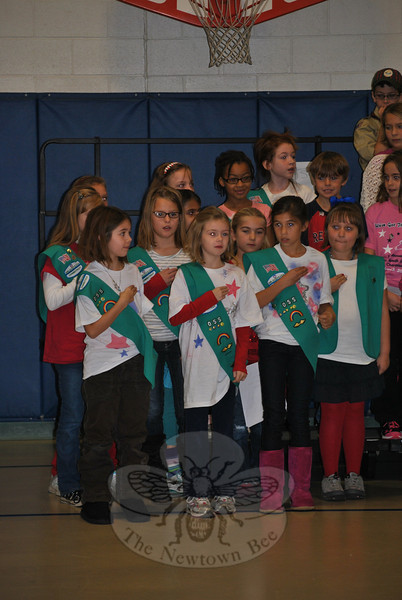 Girl Scouts led The Pledge of Allegiance during Veterans Day ceremonies at Hawley School.  (Crevier photo)