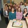 Cayenne Spremullo sliced a cake at a farewell party on November 17 in the Newtown tax collector's office, where she has worked for the past seven years. Ms Spremullo won election on November 8 to the post of tax collector for the Town of Oxford, where she has begun work. Shown at the gathering are co-workers, family, and friends. From left, front row, Andrea Santillo, Ms Spremullo, and Mindy Kovack; middle row, Carol Mahoney, Penny Mudgett, and Monica Duhancik, who is Ms Spremullo's mother; back row, Sue Marcinek, Jay Patrick, Sheila Cole, Shirley Paproski, Donna Culbert, and Chris Kelsey.  (Gorosko photo)