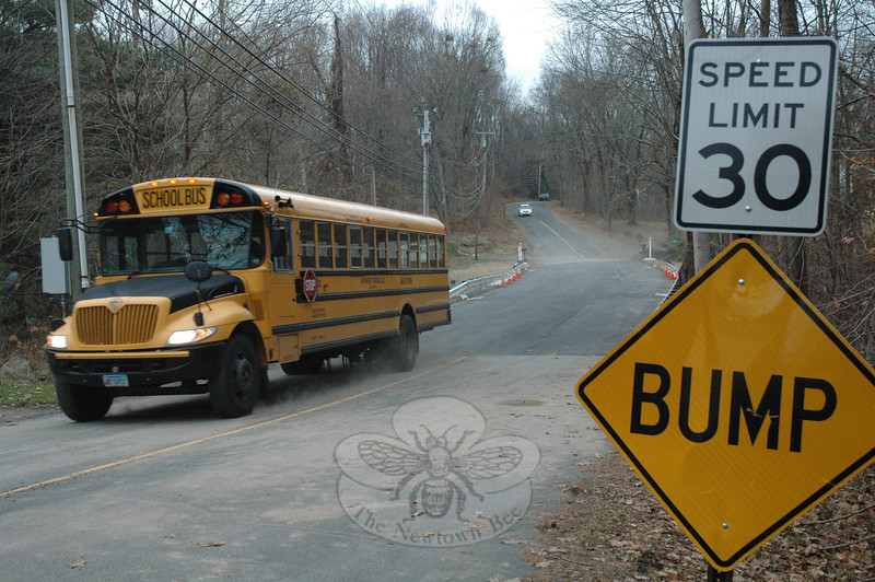 Shortly after it was reopened to through-traffic on Tuesday afternoon, a school bus travels northward on Boggs Hill Road, just south of its intersection with Sugar Street (Route 302). The northern end of Boggs Hill Road had been closed to traffic since early October to allow new drainage structures to be installed beneath the road to replace a failed culvert.  (Gorosko photo)