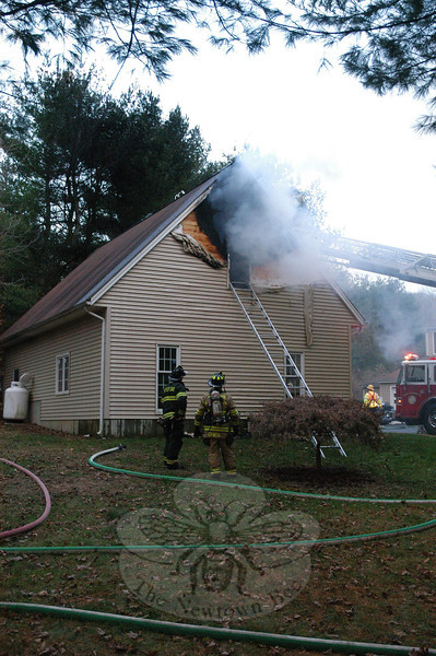 Firefighters from seven volunteer fire companies responded to 105 High Rock Road in Botsford on Monday, November 21, to extinguish a blaze that was discovered burning in office space located above a two-bay detached garage on residential property. There were no reported injuries.  (Gorosko photo)