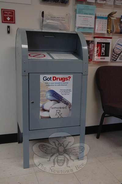 This large gray metal box located in the police station lobby at 3 Main Street is intended for residents' safe disposal of any unwanted or expired prescription drugs. The box formerly had been positioned outdoors next to the main entrance of the police station.  (Gorosko photo)