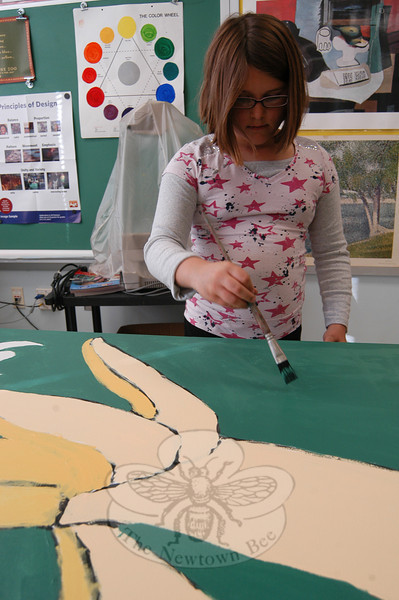 Fourth grader Holly Ankers worked on one of the canvases for the Mary Hawley Café at Hawley School. (Hallabeck photo)