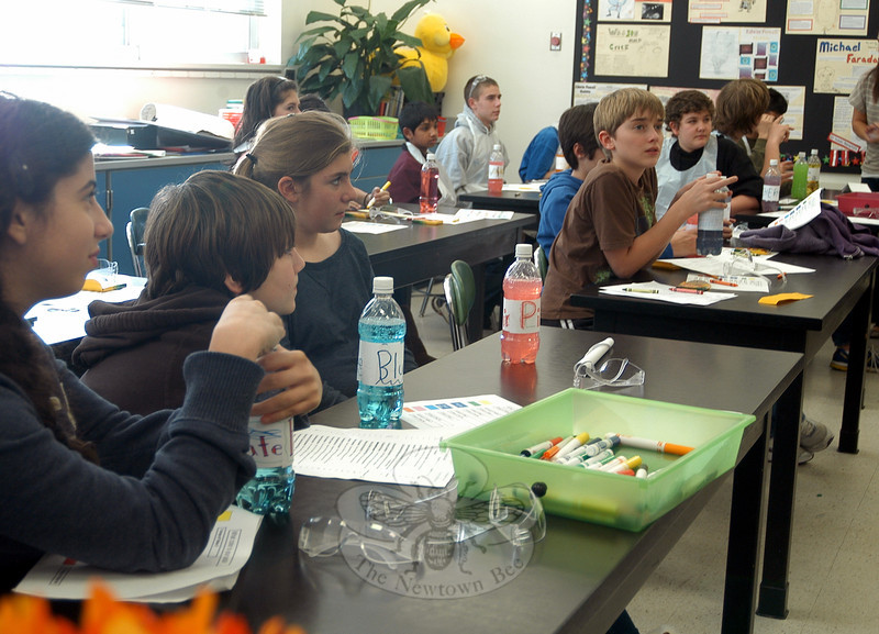 Eighth grade students sat with self-made samples of soda, ingredients provided by John Ol-szewski, director of product innovation at PepsiCo, during the middle school's Career Day. (Hallabeck photo)